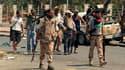 Rebelles dans le quartier d'Abou Slim, à Tripoli. Les insurgés libyens, dont les représentants se réunissent jeudi en Turquie pour préparer l'après-Kadhafi, ont commencé à nettoyer les poches de résistance des derniers partisans du régime de Mouammar Kadh
