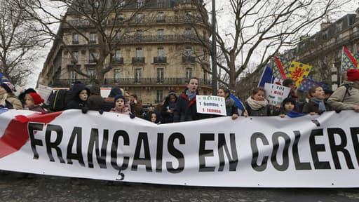 """Manifestants de """"Jour de colère"""" à Paris le 26 janvier 2014."""