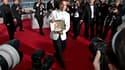 """Le Thaïlandais Apitchatpong Weerasethakul, à qui le jury du 63e Festival de Cannes présidé par le cinéaste américain Tim Burton a décerné dimanche soir la Palme d'Or pour """"Oncle Boonmee, celui qui se souvient de ses vies antérieures"""". Ce choix divise la p"""