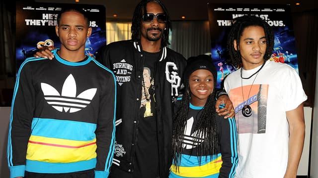 Snoop Dogg entouré de ses enfants Cordell Broadus, Cori Broadus et Corde Broadus.