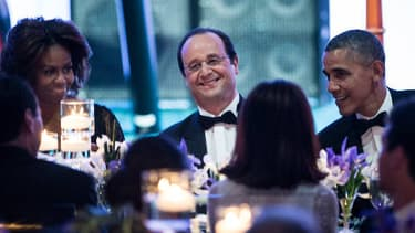François Hollande entouré de Barack et Michelle Obama, lors du dîner à la Maison Blanche.