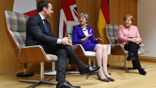 Emmanuel Macron, Theresa May et Angela Merkel à Bruxelles en mars 2018.