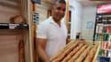 Ridha Khadher, photographié ici en 2013, dans sa boulangerie du 14e arrondissement de Paris.