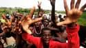 Partisans d'Alassane Ouattara à Abidjan. Plusieurs quartiers de la capitale économique de la Côte d'Ivoire ont explosé de joie lundi à l'annonce de l'arrestation de Laurent Gbagbo après dix jours de siège dans sa résidence fortifiée de Cocody. /Photo pris