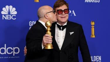 Bernie Taupin et Elton John lors de la 77e cérémonie des Golden Globes