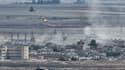 De la fumée et des explosions dans la ville frontalière de Ras al-Raïn en Syrie, le 13 octobre 2019.