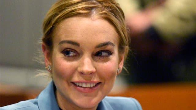 L'actrice américaine Lindsay Lohan a été arrêtée dans la nuit de mardi à mercredi pour délit de fuite après avoir heurté un piéton avec sa voiture à New York. /Photo prise le 29 mars 2012/REUTERS/Joe Klamar/Pool