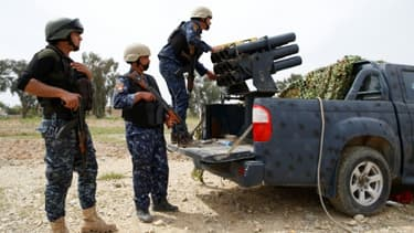 Des membres de la 9e division de l'armée irakienne, dans l'ouest de Mossoul, le 8 avril 2017