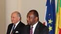 Laurent Fabius et le ministre malien des Affaires étrangères Tieman Hubert Coulibaly à Bamako. Le chef de la diplomatie française a insisté sur le respect des échéances fixées pour le retrait des forces françaises et la tenue d'élections, malgré la persis