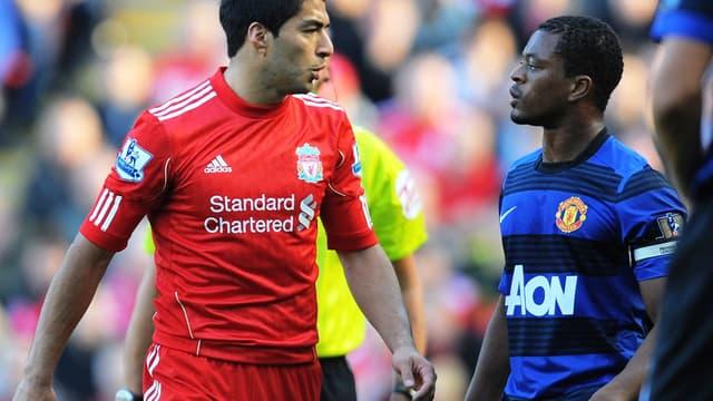 Luis Suarez et Patrice Evra, lors d'un Liverpool-MU