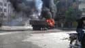 A Irbin, dans la banlieue de Damas, après un bombardement samedi. Les forces de Bachar al Assad ont poursuivi samedi soir leur contre-offensive à Damas tout en essayant de reprendre aux insurgés un quartier d'Alep, nouveau front dans la bataille entre le