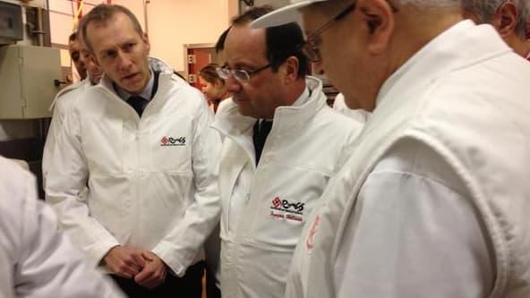 François Hollande et Guillaume Garot en visite au pavillon carné à Rungis