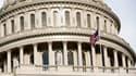 L'accord sur le relèvement du plafond de la dette américaine a été adopté lundi soir par la Chambre des représentants par 269 voix contre 161 et sera examiné mardi par le Sénat. /Photo prise le 1er août 2011/REUTERS/Joshua Roberts