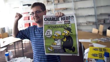 Charb à la rédaction de Charlie Hebdo en septembre 2012.