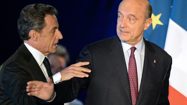Nicolas Sarkozy et Alain Juppé lors du meeting de l'ancien président à Bordeaux le 22 novembre dernier